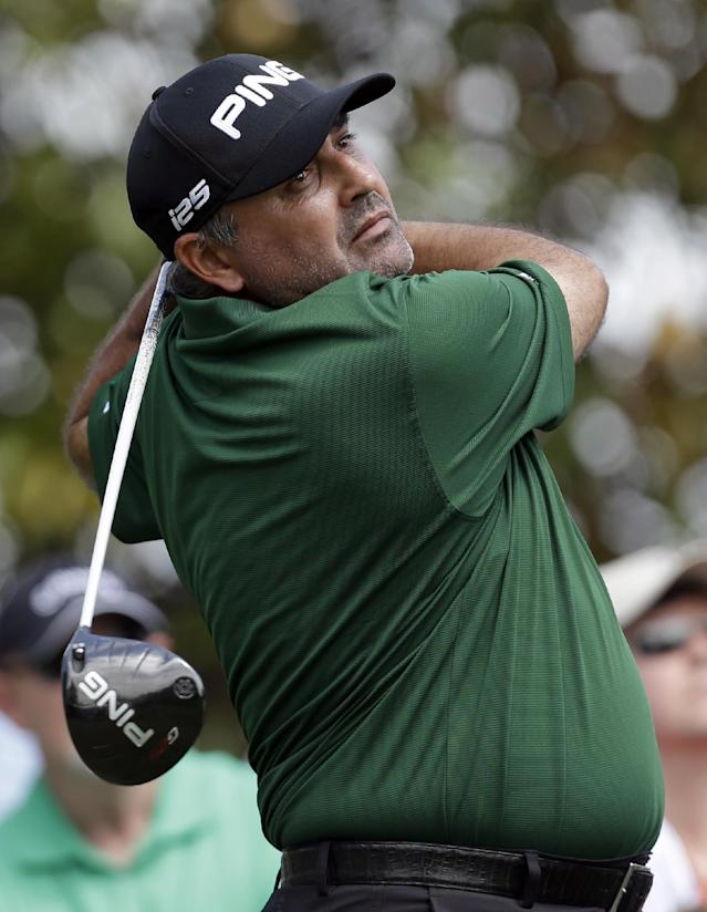 Angel Cabrera, of Argentina, watches his tee shot on the 16th hole during the first round of the Wells Fargo Championship golf tournament in Charlotte, N.C., Thursday, May 1, 2014. (AP Photo/Bob Leverone)