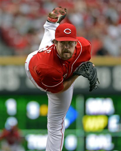 Cincinnati Reds' Sam LeCure pitches in the eighth inning of a baseball game against the Seattle Mariners at Great American Ball Park in Cincinnati, Saturday, July 6, 2013. The Reds won 13-4. (AP Photo/Michael E. Keating)