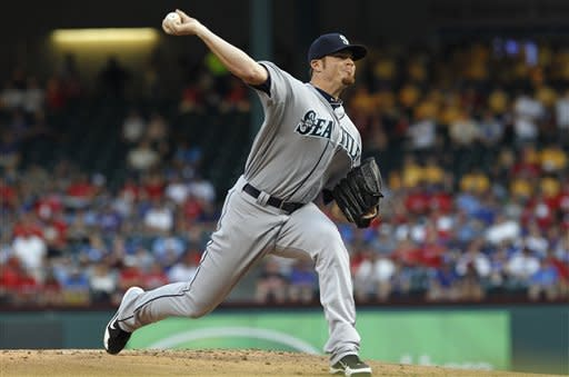 Seattle Mariners starting pitcher Blake Beavan throws during the first inning of a baseball game against the Texas Rangers on Tuesday, April 10, 2012, in Arlington, Texas. (AP Photo/LM Otero)