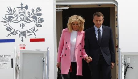 French President Emmanuel Macron and his wife Brigitte Macron arrive for their state visit to Washington and meetings with U.S. President Donald Trump after landing at Joint Base Andrews in Maryland, U.S. April 23, 2018. REUTERS/Brian Snyder