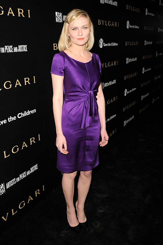 """Kirsten Dunst made sure she stood out in a purple Prada frock. Jason Merritt/<a href=""""http://www.gettyimages.com/"""" target=""""new"""">GettyImages.com</a> - January 13, 2011"""