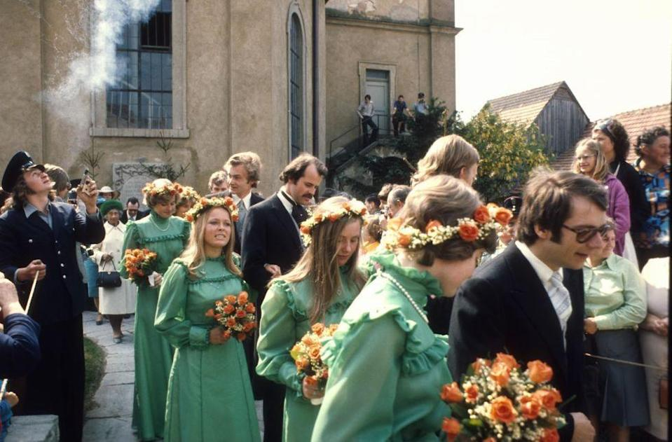 <p>At a royal wedding in Germany, the bridesmaids sported high-necked green dresses accented with flower crowns adorned with baby's breath, a trademark of bridesmaid fashion in the '70s.</p>