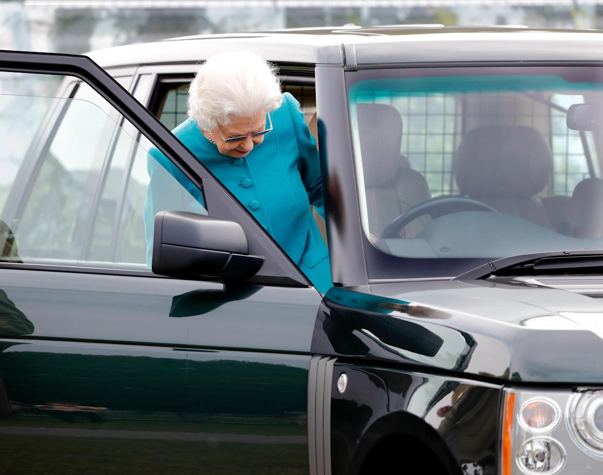 WINDSOR, UNITED KINGDOM - JULY 01: (EMBARGOED FOR PUBLICATION IN UK NEWSPAPERS UNTIL 24 HOURS AFTER CREATE DATE AND TIME) Queen Elizabeth II seen getting into her Range Rover car as she attends day 1 of the Royal Windsor Horse Show in Home Park, Windsor Castle on July 1, 2021 in Windsor, England. (Photo by Max Mumby/Indigo/Getty Images)