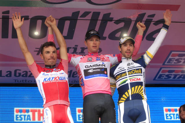 Giro winner Ryder Hesjedal of Canada (C), second-placed Joaquim Rodriguez of Spain (L) and Thomas De Gendt of Belgium (R) celebrate on the podium during the final ceremony of the Tour of Italy (Giro d'Italia) cycling race on May 27, 2012 in Milano. AFP PHOTO / LUK BENIESLUK BENIES/AFP/GettyImages