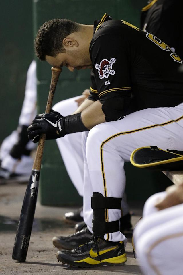 Pittsburgh Pirates catcher Russell Martin sits in the dugout preparing to hit during the second inning of a baseball game against the San Diego Padres in Pittsburgh Monday, Sept. 16, 2013. (AP Photo/Gene J. Puskar)