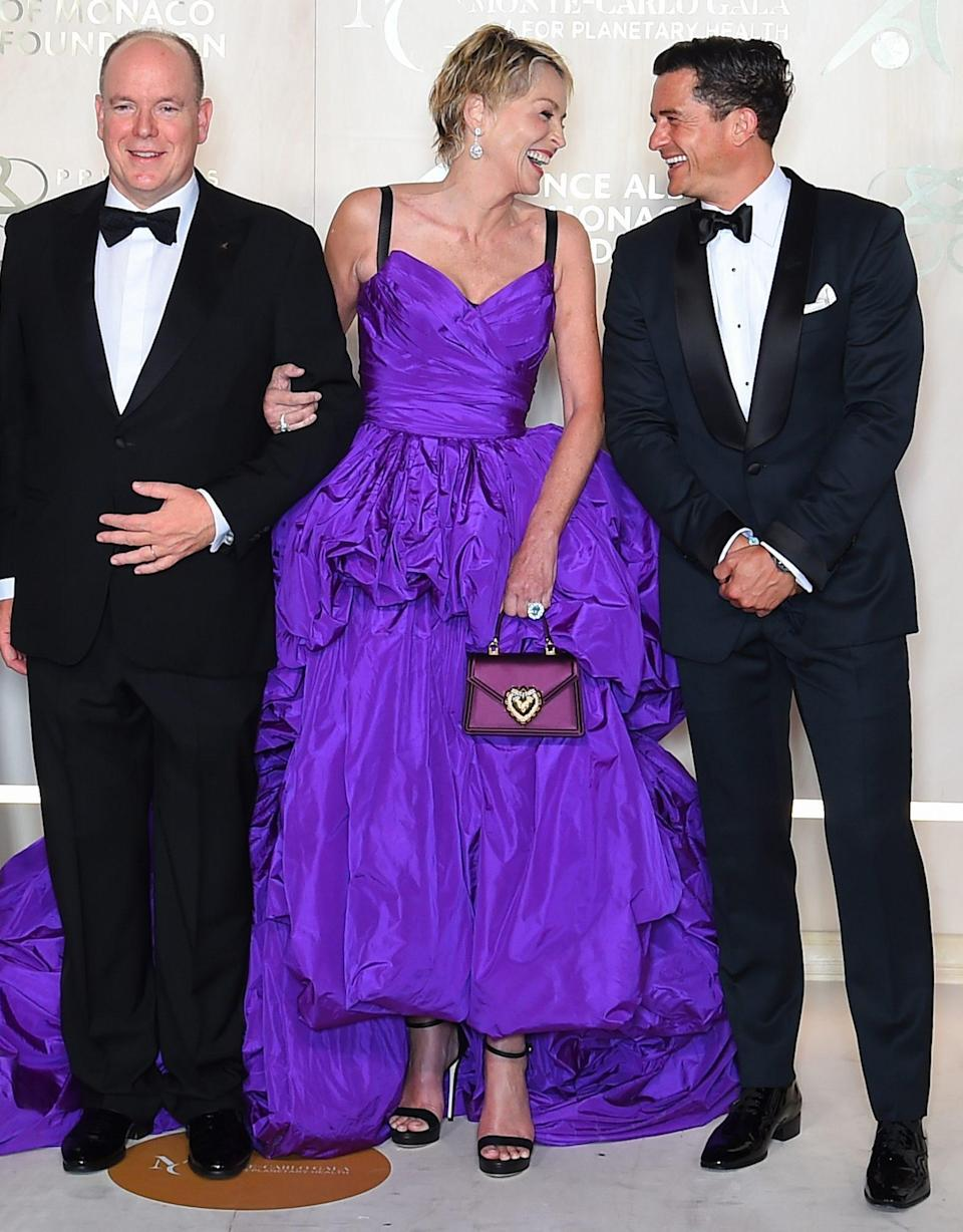 <p>Prince Albert II of Monaco greets Sharon Stone and Orlando Bloom at the 5th Monte-Carlo Gala for Planetary Health in Monaco on Sept. 23. </p>
