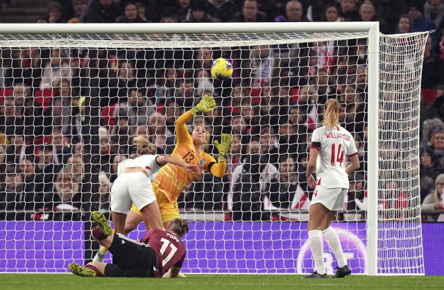 Germany's Alexandra Popp , left, scores her side's first goal during the Women's International Friendly soccer match between England and Germany, at Wembley Stadium, in London, Saturday, Nov. 9, 2019. (John Walton/PA via AP)
