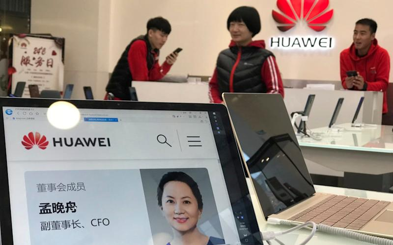 A profile of Huawei's chief financial officer Meng Wanzhou is displayed on a Huawei computer at a Huawei store in Beijing, China - AP