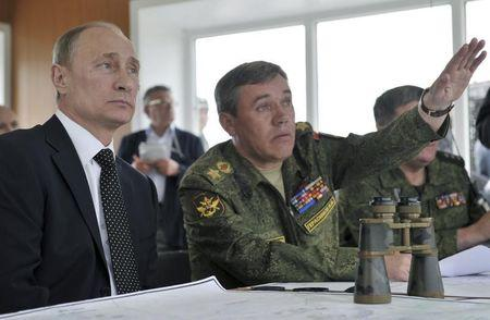 Russian President Putin and Chief of Staff Gerasimov watch military exercises in Russia's Zabaykalsky region