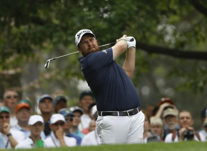 Shane Lowry, of Ireland, hits on the fourth hole during the first round for the Masters golf tournament Thursday, April 11, 2019, in Augusta, Ga. (AP Photo/Matt Slocum)