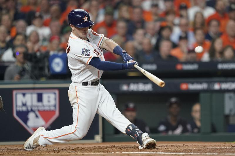 Houston Astros' Alex Bregman hits a two-run home run during the first inning of Game 2 of the baseball World Series against the Washington Nationals Wednesday, Oct. 23, 2019, in Houston. (AP Photo/Eric Gay)