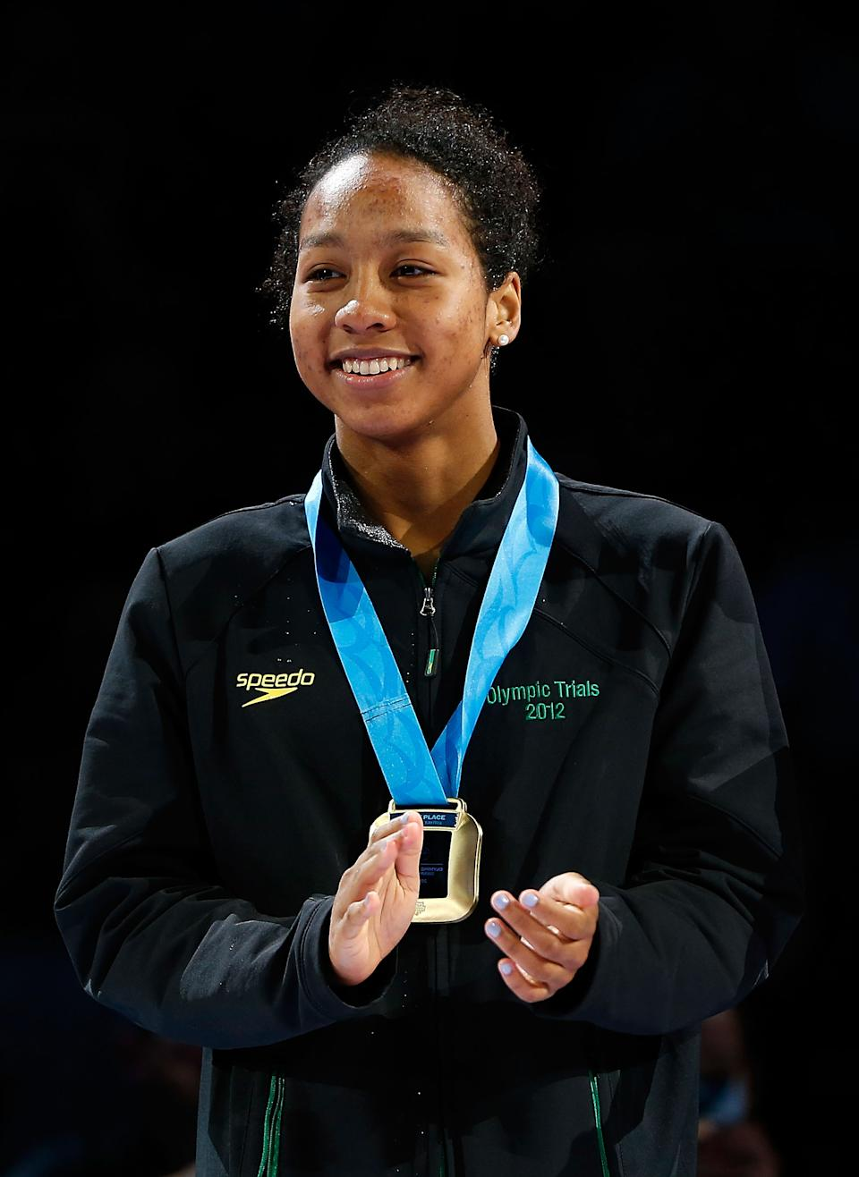 Lia Neal, 17, celebrates during the medal ceremony for the Women's 100 m Freestyle during Day Six of the 2012 U.S. Olympic Swimming Team Trials at CenturyLink Center on June 30, 2012 in Omaha, Nebraska. (Photo by Jamie Squire/Getty Images)