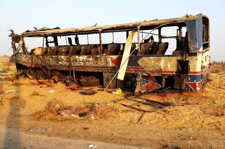 This imaged released on the official Facebook page of the Egyptian Military Spokesman of the Armed Forces, shows a destroyed bus, after a suicide attacker hit his explosive-laden car into the bus at the road between the border town of Rafah and the coastal city of el-Arish, Egypt, Wednesday, Nov. 20, 2013. A suicide bomber rammed his explosive-laden car into one of two buses carrying off-duty soldiers in Egypt's turbulent region of northern Sinai on Wednesday, killing nearly a dozen and wounding dozens more, security and military officials said. (AP Photo/The Official Facebook Page of the Egyptian Military Spokesman of the Armed Forces)