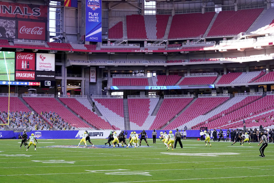 Iowa State and Oregon compete during the first half of the Fiesta Bowl NCAA college football game, Saturday, Jan. 2, 2021, in Glendale, Ariz. (AP Photo/Ross D. Franklin)