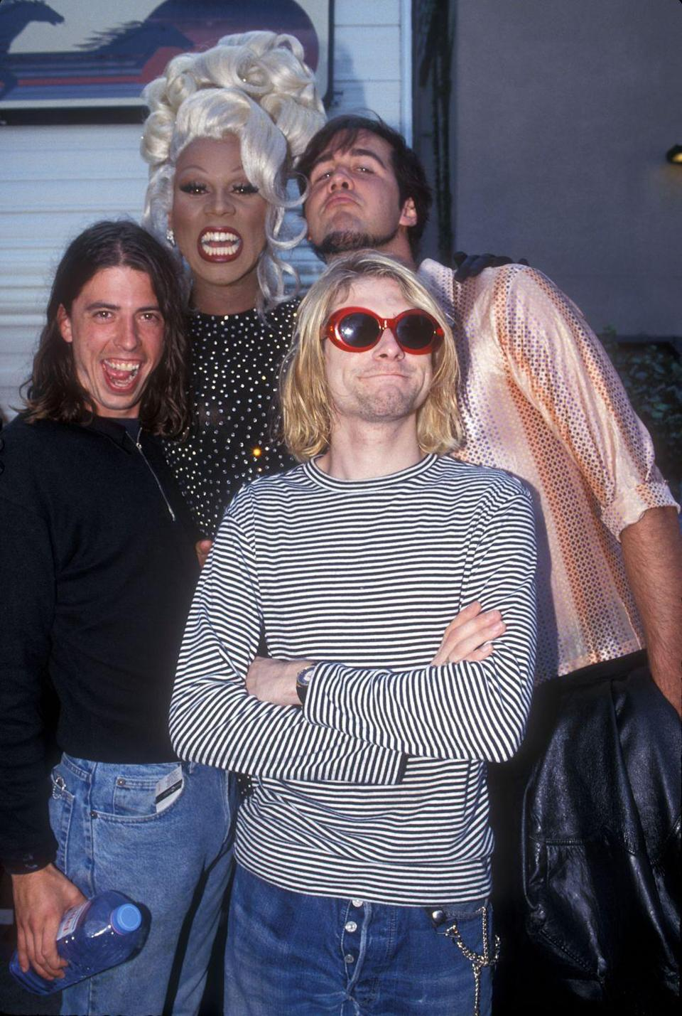<p>Speaking of celebrities, peep Ru surrounded by Kurt Cobain, Krist Novoselic and Dave Grohl of Nirvana.</p>