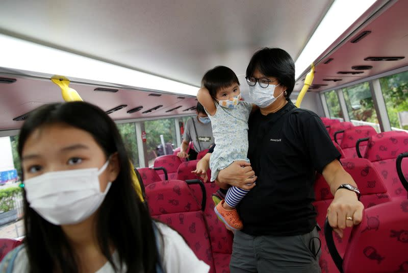 The Wider Image: Leaving Hong Kong: A family makes a wrenching decision