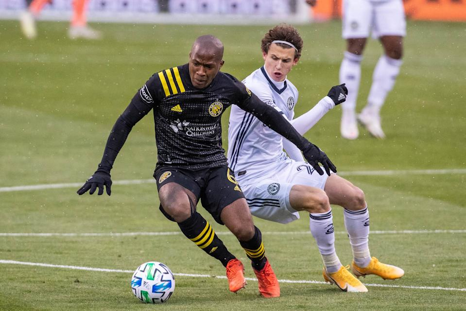 Columbus Crew SC midfielder Darlington Nagbe (6) dribbles the ball while Philadelphia Union midfielder Brenden Aaronson during a game on Nov. 1.