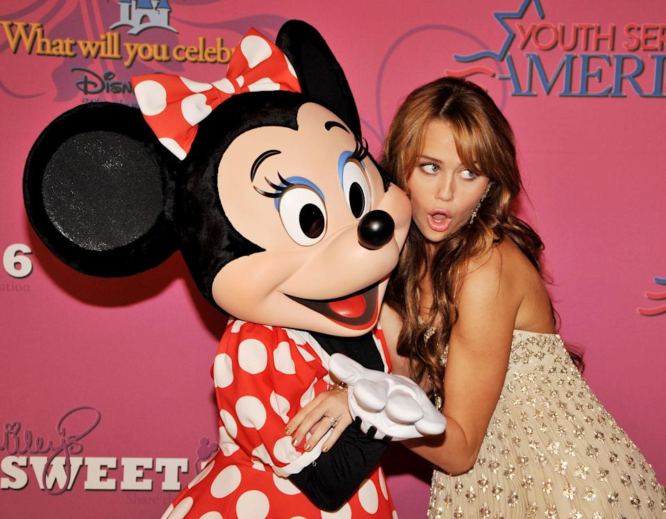 Minnie and Miley hammed it up on the red carpet. (Photo: Kevin Winter/Getty Images)