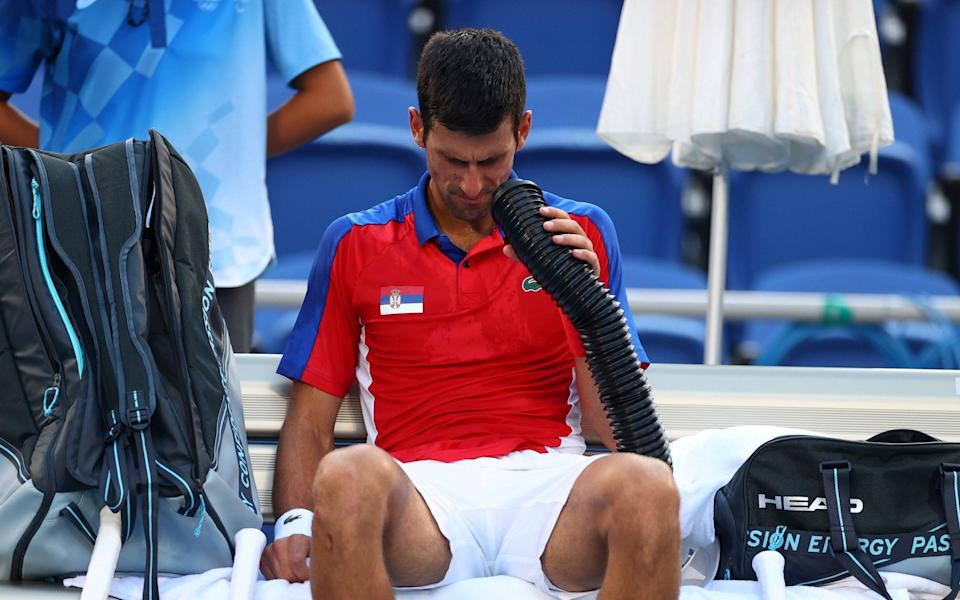 Keeping his cool: Djokovic still has a shot at a medal in the doubles - REUTERS