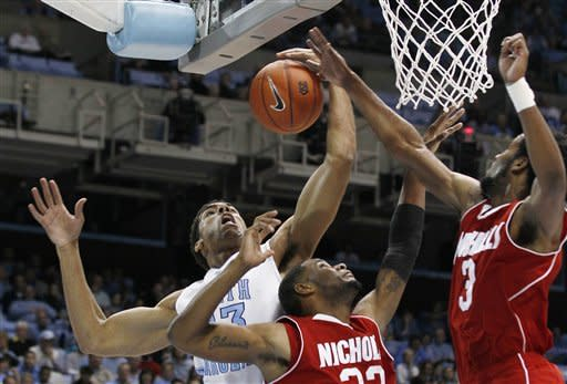 North Carolina's James Michael McAdoo, left, battles with Nicholls State's Trevon Lewis and Bryan Hammond (3) during the first half of an NCAA college basketball game in Chapel Hill, N.C., Monday, Dec. 19, 2011. (AP Photo/Gerry Broome)