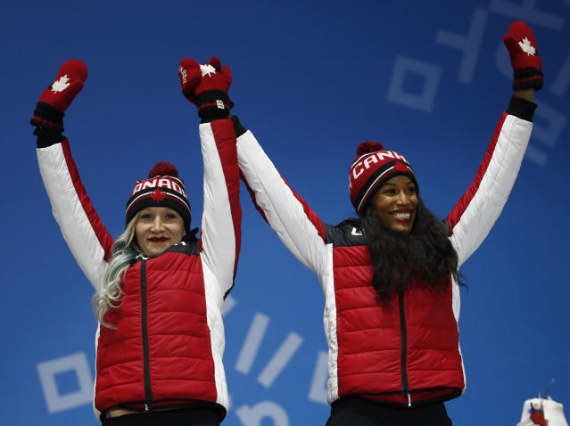 Bronze medalist in the women's two-man bobsled Kaillie Humphries and Phylicia George, of Canada, celebrate during the medals ceremony at the 2018 Winter Olympics in Pyeongchang, South Korea, Thursday, Feb. 22, 2018. (AP Photo/Patrick Semansky)