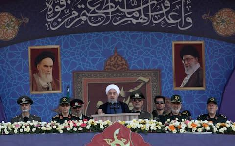 Iranian President Hassan Rouhani delivers a speech during the ceremony of the National Army Day parade in Tehran - Credit: Wana News Agency