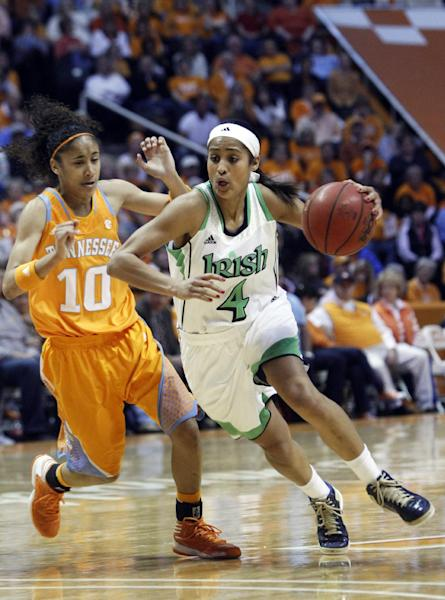 Notre Dame guard Skylar Diggins (4) drives past Tennessee guard Meighan Simmons (10) in the second half of an NCAA college basketball game on Monday, Jan. 28, 2013, in Knoxville, Tenn. Notre Dame won 77-67. (AP Photo/Wade Payne)