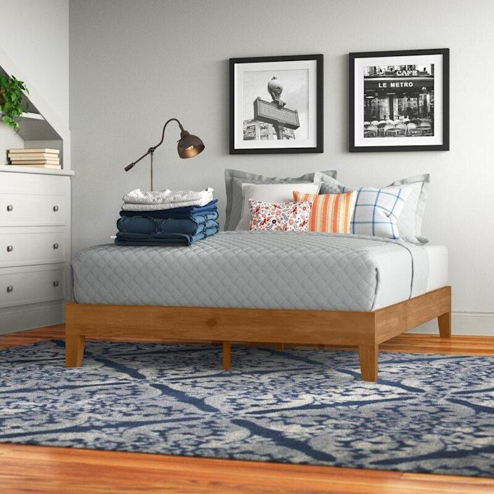 """Though it doesn't have a headboard or the environmental sourcing of the Thuma, this Wayfair model was also a hit and comes in at less than $200. $202, Wayfair. <a href=""""https://www.wayfair.com/furniture/pdp/red-barrel-studio-harney-solid-wood-low-profile-platform-bed-bpmt1258.html?rtype=8&redir=BPMT1258"""" rel=""""nofollow noopener"""" target=""""_blank"""" data-ylk=""""slk:Get it now!"""" class=""""link rapid-noclick-resp"""">Get it now!</a>"""