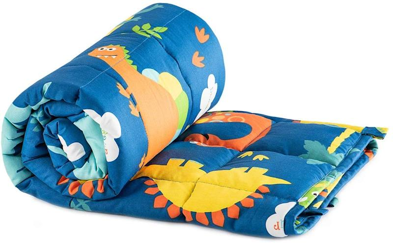 Treat your little one to a dino-mite weighted blanket. (Photo: Amazon)