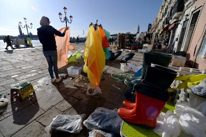 Local business owners remained defiant in the face of the flooding (AFP Photo/Filippo MONTEFORTE )