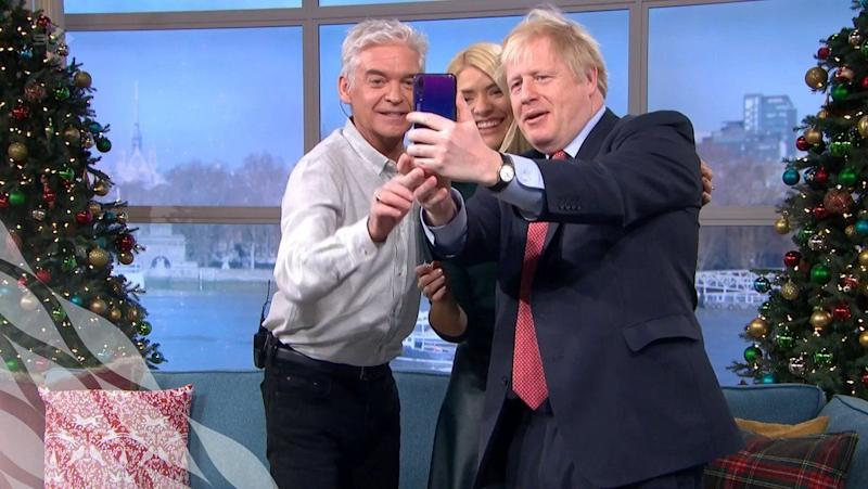 Phillip Schofield, Holly Willoughby and Boris Johnson take a selfie after the PM's This Morning interview (Photo: ITV)