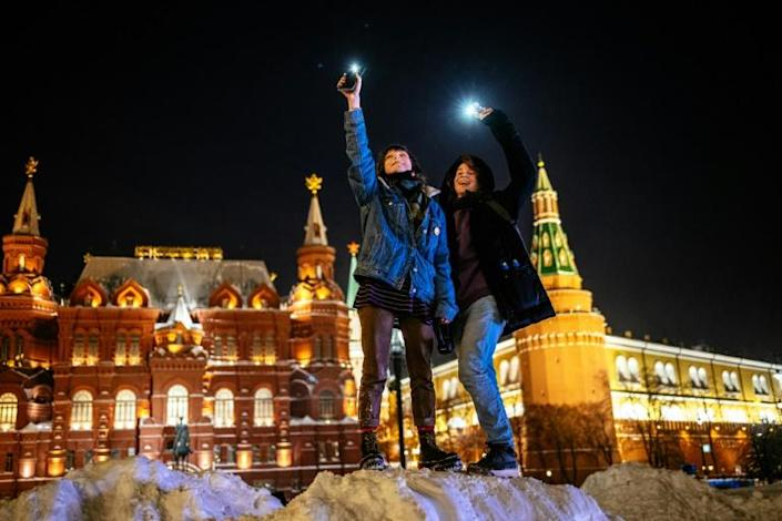 Mobile phone lights showed support for jailed opposition politician Alexei Navalny near Red Square in Moscow and in many other parts of the country