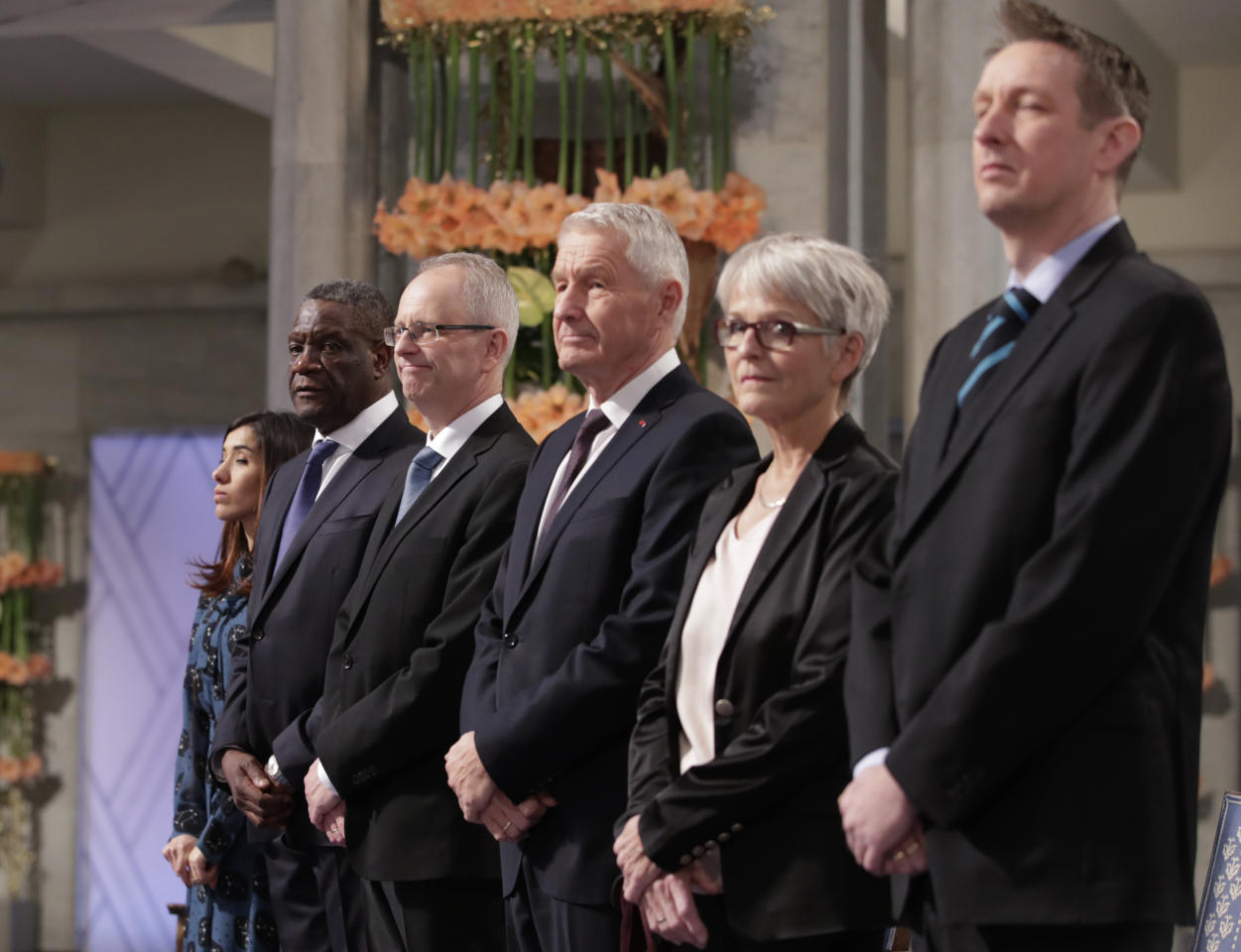 The Peace Price laureates, from left, Nadia Murad from Iraq and Dr. Denis Mukwege from Congo, pose with Henrik Syse, Thorbjorn Jagland, Anne Enger and Asle Toje, during the Nobel Peace Prize Ceremony in Oslo Town Hall, Oslo, Monday Dec. 10, 2018. Dr. Denis Mukwege and Nadia Murad receive the Nobel Peace Prize recognising their efforts to end the use of sexual violence as a weapon of war and armed conflict. (Haakon Mosvold Larsen / NTB scanpix via AP)