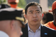 New York City mayoral candidate Andrew Yang attends a vigil at the scene where 10-year old Justin Wallace was shot and killed the previous Saturday night in the Rockaway section of the Queens borough of New York, Wednesday, June 9, 2021. The Democratic primary race for New York City mayor is nearing the finish line with a surge in shootings pushing public safety to the top of some voters' concerns. (AP Photo/John Minchillo)