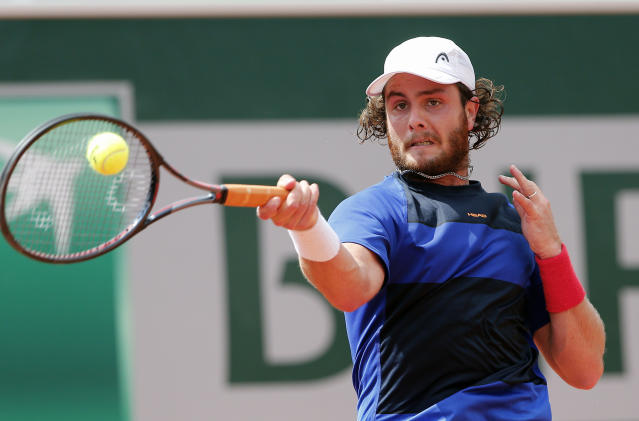 FILE - In this Wednesday, May 30, 2018 file photo Argentina's Marco Trungelliti returns the ball to Italy's Marco Cecchinato during their second round match of the French Open tennis tournament at the Roland Garros stadium in Paris. Blowing the whistle on betting-related corruption that is eating at tennis' credibility has come at a cost for the Argentine whose mad-dash road trip to Roland Garros last year caused a sensation. (AP Photo/Thibault Camus, File)