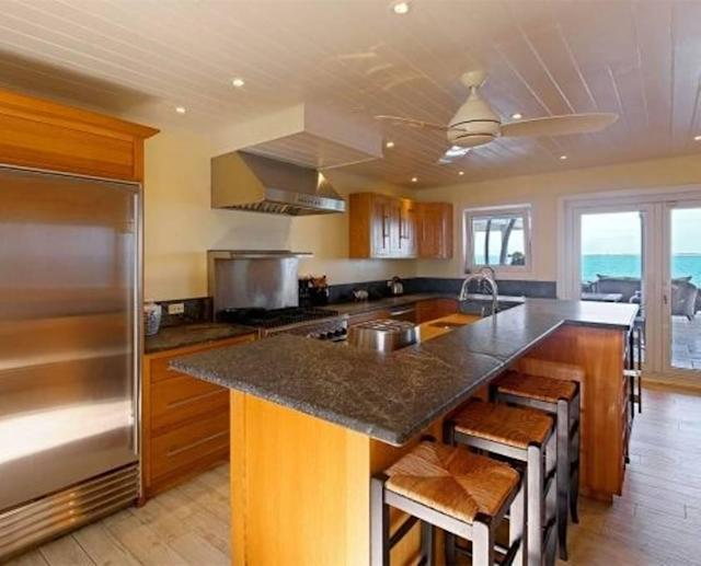 <p>The modern, well-appointed kitchen has a wine fridge. <br>(Airbnb) </p>