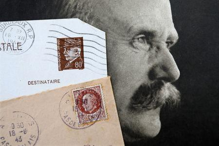 """Stamps and a portrait of French General Philippe Petain, published in the French newspaper ''L'Illustration"""" on May 5, 1917 (R), are seen in this picture illustration taken November 8, 2018. REUTERS/Charles Platiau/Illustration"""