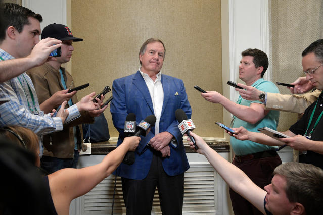 FILE - In this March 27, 2018, file photo, New England Patriots head football coach Bill Belichick, center, answers questions from reporters at the coaches breakfast during the NFL owners meetings, in Orlando, Fla. The Patriots have mostly been sellers in recent NFL drafts, often moving down on the board or being content to search for gems in the undrafted player pool. This year they dont have that luxury with several holes to fill, including one behind 40-year-old quarterback Tom Brady.(Phelan M. Ebenhack/AP Images for NFL, File)