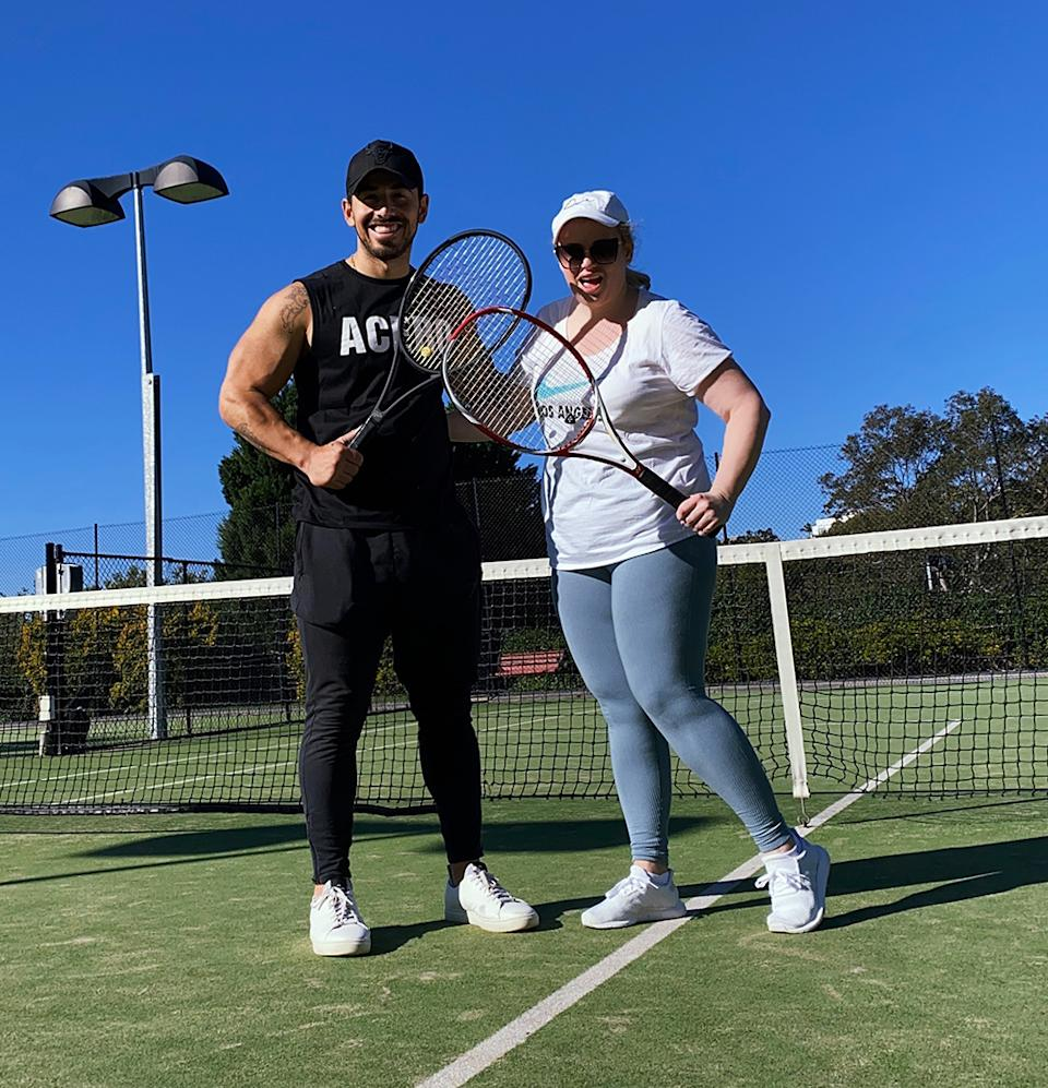 Jono Castano and Rebel Wilson play tennis
