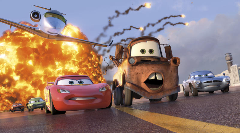 """FILE - In this file film publicity image released by Disney-Pixar, animated characters Lightning McQueen, voiced by Owen Wilson, foreground left, Mater, voiced by Larry the Cable Guy, center, and Finn McMissile, voiced by Michael Caine, right, are shown in a scene from """"Cars 2."""" """"Cars 2"""" went out this summer in 44 different languages. And every country faced the same problem when it came to dubbing the aw-shucks ramblings of one of the movie's lead characters _ the country bumpkin tow truck Mater, voiced in the movie by Larry the Cable Guy.   (AP Photo/Disney/Pixar, File)"""