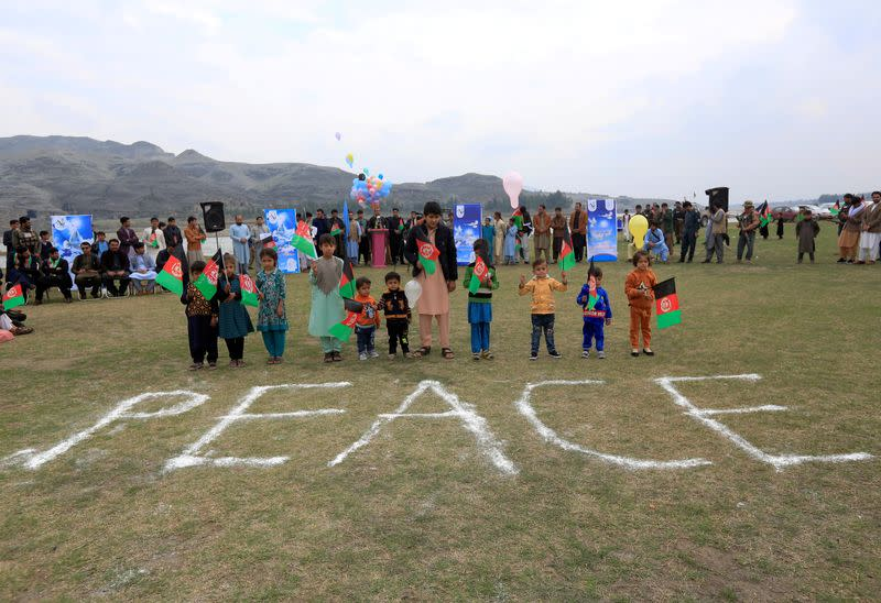 FILE PHOTO: Afghan children celebrate in anticipation of the U.S-Taliban agreement to allow a U.S. troop reduction and a permanent ceasefire, in Jalalabad