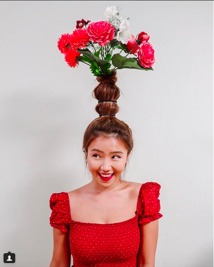 """<p>The love for all things floral made its way to hairstyles too with many being inspired by Beyonce's look on the cover of Vogue. It might be a fun way to add a couple of inches to your height, but that's about the only advantage we see! <br />Photograph: <a rel=""""nofollow"""" href=""""https://www.instagram.com/p/Bn0lR_dA7DV/"""">moonieckm/Instagram</a> </p>"""