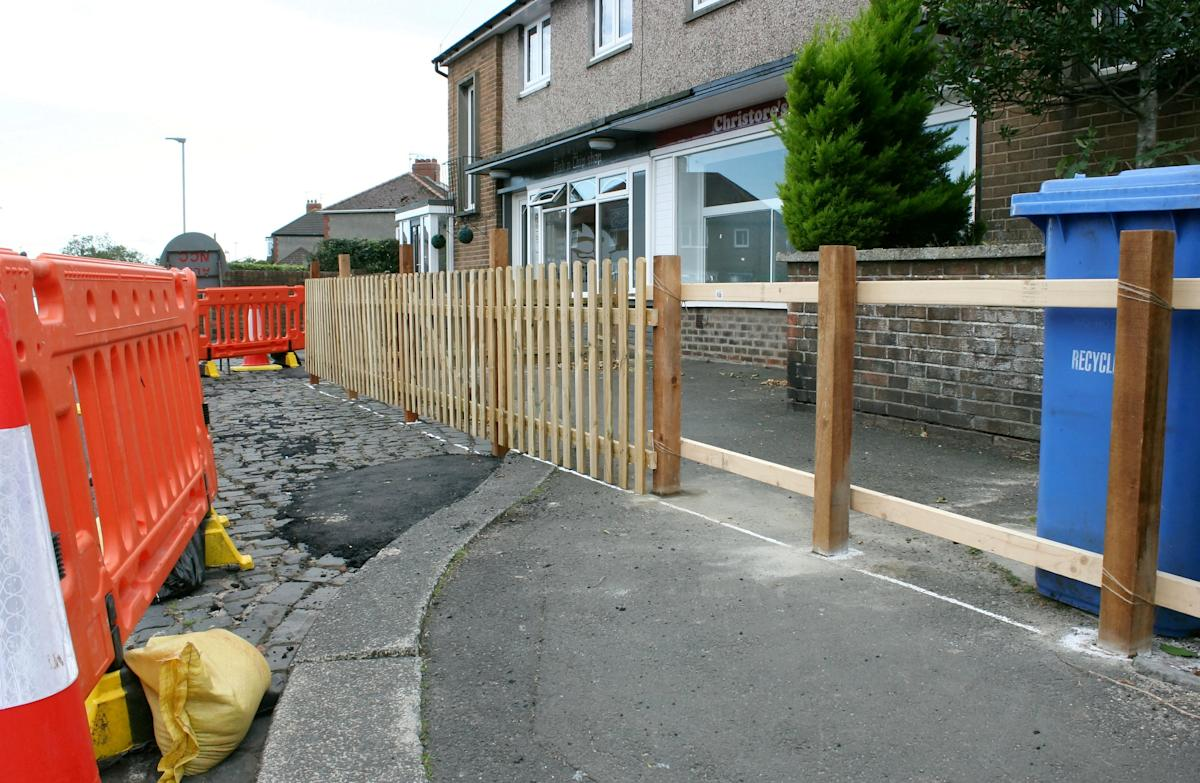 Fed-up homeowner builds fence on footpath to stop people eating chips on his wall