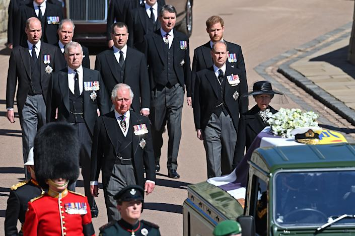 WINDSOR, UNITED KINGDOM - APRIL 17: (EMBARGOED FOR PUBLICATION IN UK NEWSPAPERS UNTIL 24 HOURS AFTER CREATE DATE AND TIME) Prince Charles, Prince of Wales, Princess Anne, Princess Royal, Prince Andrew, Duke of York, Prince Edward, Earl of Wessex, Prince William, Duke of Cambridge, Peter Phillips, Prince Harry, Duke of Sussex, David Armstrong-Jones, 2nd Earl of Snowdon and Vice Admiral Sir Timothy Laurence follow Prince Philip, Duke of Edinburgh's coffin (draped in his Royal Standard Flag and bearing his Royal Navy cap, sword and a bouquet of lilies, white roses, freesia and sweet peas) as it is carried on a specially designed Land Rover Defender hearse during his funeral procession to St. George's Chapel, Windsor Castle on April 17, 2021 in Windsor, England. Prince Philip of Greece and Denmark was born 10 June 1921, in Greece. He served in the British Royal Navy and fought in WWII. He married the then Princess Elizabeth on 20 November 1947 and was created Duke of Edinburgh, Earl of Merioneth, and Baron Greenwich by King VI. He served as Prince Consort to Queen Elizabeth II until his death on April 9 2021, months short of his 100th birthday. His funeral takes place today at Windsor Castle with only 30 guests invited due to Coronavirus pandemic restrictions. (Photo by Pool/Max Mumby/Getty Images)