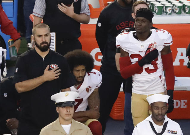 "FILE - In this Thursday, Sept. 1, 2016, file photo, San Francisco 49ers quarterback Colin Kaepernick, middle, kneels during the national anthem before the team's NFL preseason football game against the San Diego Chargers, in San Diego. NFL owners have approved a new policy aimed at addressing the firestorm over national anthem protests, permitting players to stay in the locker room during the ""The Star-Spangled Banner"" but requiring them to stand if they come to the field. The decision was announced Wednesday, May 23, 2018, by NFL Commissioner Roger Goodell during the league's spring meeting in Atlanta.(AP Photo/Chris Carlson, File)"