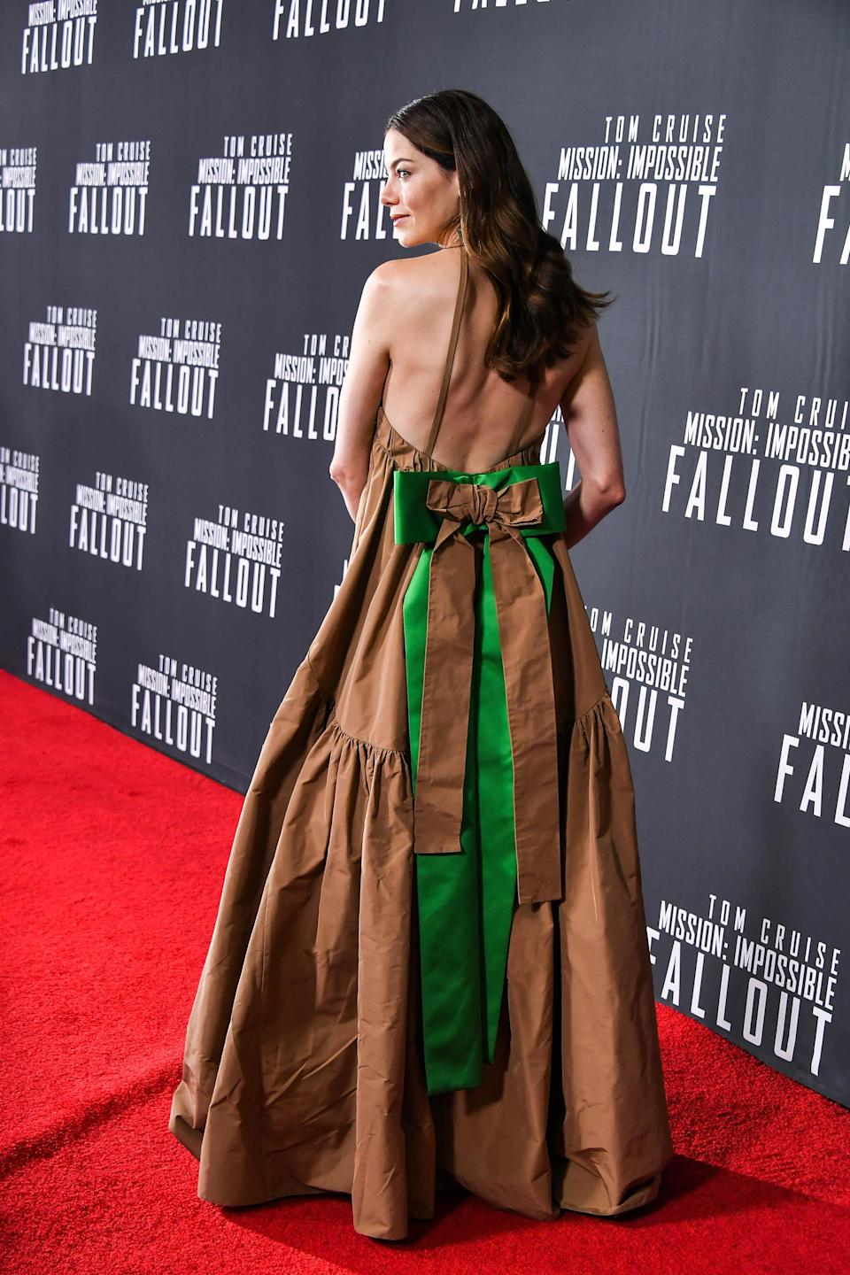 <p>Michelle looked pretty as a present in this bow, backless Rochas dress. <em>[Photo: Getty]</em> </p>