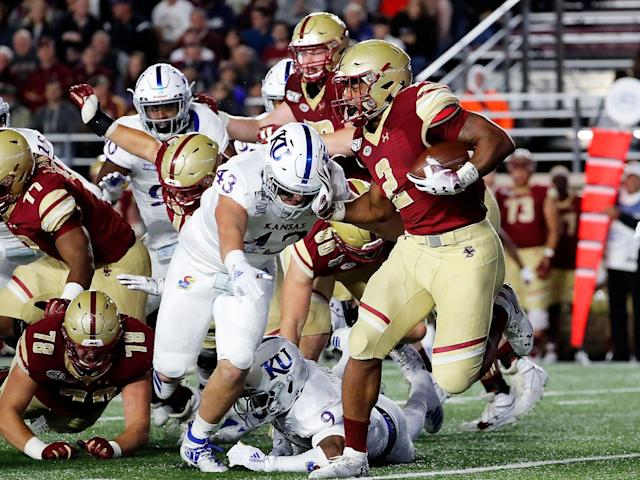 <p>Kansas wide receiver Jay Dineen (43) moves in to tackle Boston College running back AJ Dillon (2) during a game between the Eagles and the Jayhawks on Sept. 13, 2019.</p>