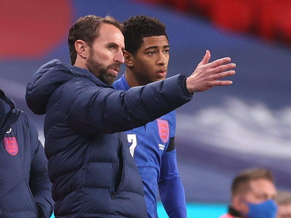 England youngster Jude Bellingham with coach Gareth SouthgateGetty Images