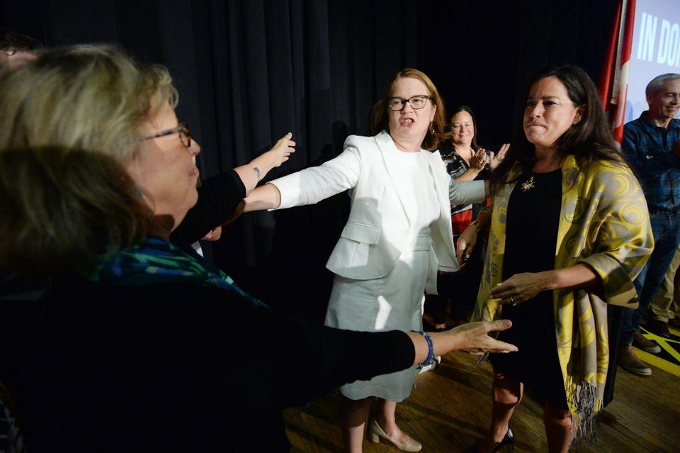 Independent candidates Jody Wilson-Raybould and Jane Philpott and Green Party Leader Elizabeth May hug following an election campaign event for Wilson-Raybould in Vancouver on Sept. 18, 2019.