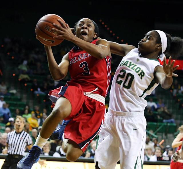 Mississippi's Valencia McFarland, left, drives past Baylor guard Imani Wright during the first half of an NCAA college basketball game, Wednesday, Dec. 18, 2013, in Waco, Texas. (AP Photo/Waco Tribune Herald, Rod Aydelotte)